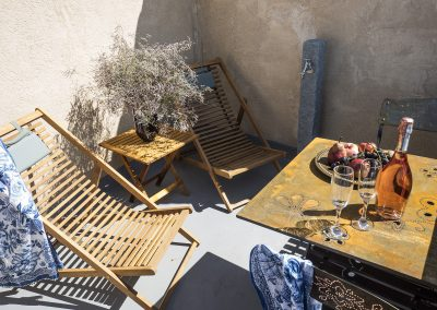 Coronell_terrasse_fauteuils_fontaine